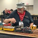 Men playing with trains
